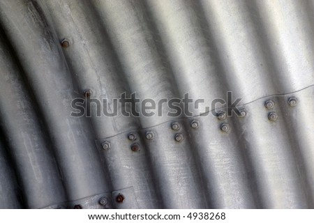 Waves of an asbestos cement piping in a mine - stock photo