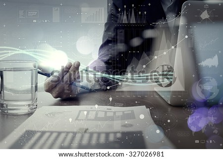 Waves of blue light and businessman using on laptop computer with digital layer effect  as concept                 - stock photo