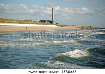 Waves of the Northsea, beach and radar tower for navigation help in Domburg the Netherlands - stock photo