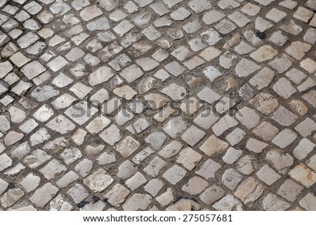 Waves of tiled floor in portuguese traditional style - stock photo