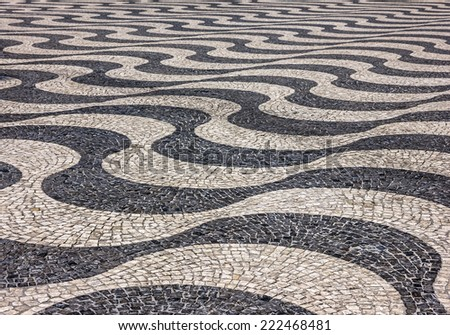 Waves of tiled floor in Portuguese traditional style, Rossio square, Lisbon - stock photo