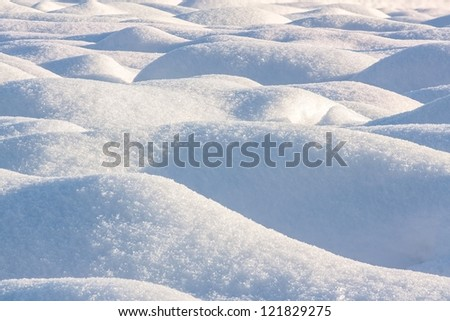 waves on a snowy field - stock photo