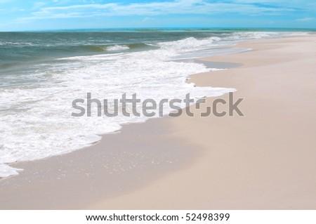 Waves on beach on pretty gulf coast - stock photo