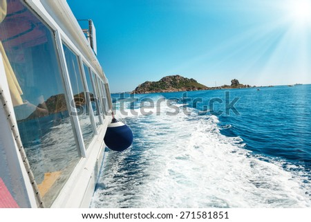 Waves on blue sea behind the speed boat in sunny day - stock photo