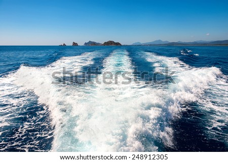Waves on blue sea behind the speed boat water in sunny day - stock photo