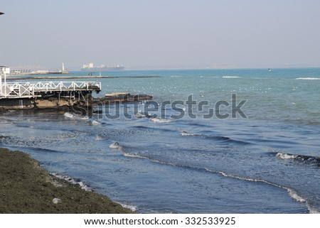 Waves on cerulean sea water at the beach in autumn