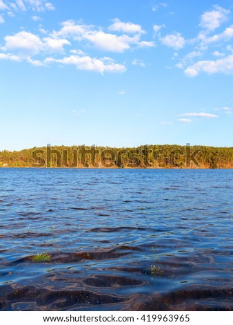 Waves on Hracholusky dam. Water reservoir and famous fishing place in Czech republic, European Union. - stock photo