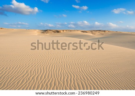 Waves on sand dunes  in Chaves beach Praia de Chaves in Boavista Cape Verde - Cabo Verde - stock photo