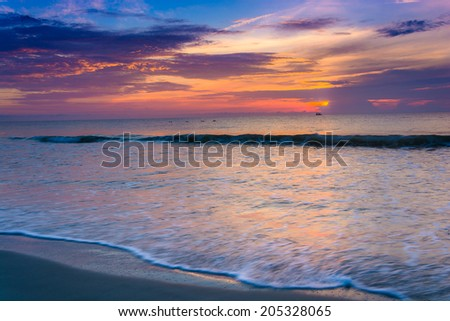 Waves on the Atlantic Ocean at sunrise, St. Augustine Beach, Florida. - stock photo