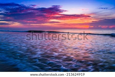 Waves on the Atlantic Ocean at sunrise, St. Augustine Beach, Florida. - stock photo