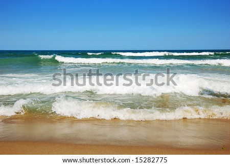 Waves on the beach - stock photo