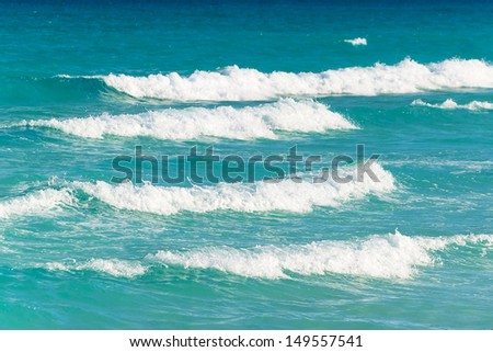 Waves on the Caribbean Sea in Mexico - stock photo