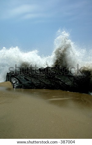 Waves on the Rocks - stock photo