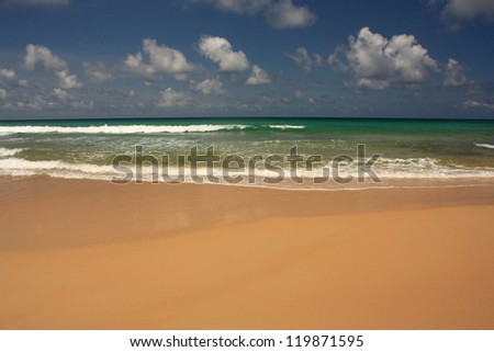 Waves on the tropical, exotic, sandy beach - stock photo