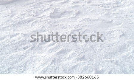 waves on winter white snow texture background  - stock photo
