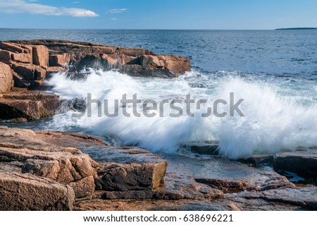 Waves Pounding the Red Granite Rock