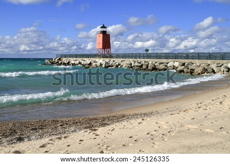 Waves roll in on a fall day at the beach of Charlevoix, Michigan.  - stock photo