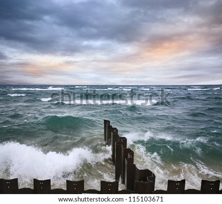 Waves Rolling Toward The Seawall At The Point Betsie Lighthouse On Lake Michigan, USA - stock photo