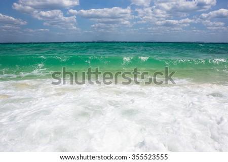 Waves running on the beach of Andaman sea, Krabi province, Thailand - stock photo