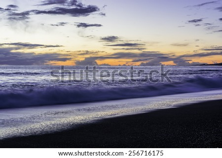 Waves, sand, blue sky and sea at sunset, on Moonstone Beach, California Central Coast, near Cambria CA. - stock photo