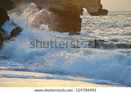 waves splash at stones on shore sea