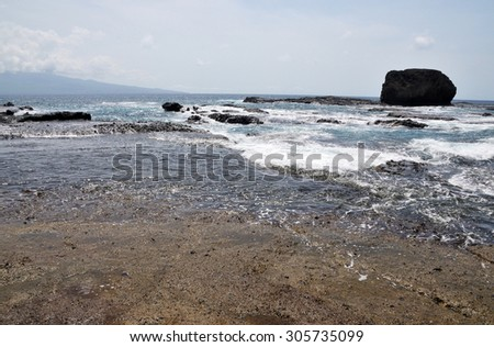 Waves wash over the rock banks found on the coast of the islet of Djeu in the archipelago of Cabo Verde