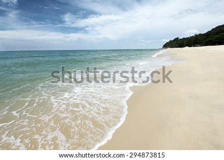 Waves washing onto sandy beach