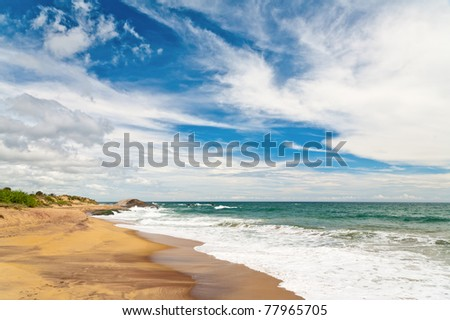 Waves washing up onto an empty beach in Sri Lanka