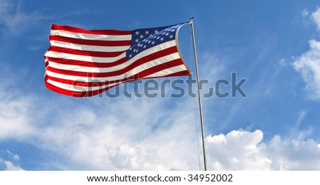 Waving American flag against a blue sky background