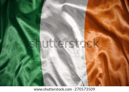 waving and shining irish flag - stock photo