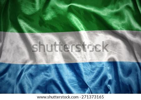 waving and shining sierra leone flag - stock photo