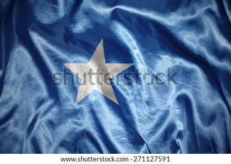 waving and shining somalia flag - stock photo