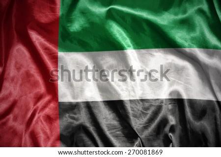 waving and shining united arab emirates flag - stock photo