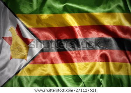 waving and shining zimbabwean flag - stock photo