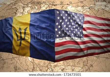 Waving Barbados and American flags on the of the political map of the world