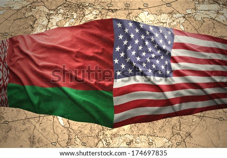 Waving Belorussian and American flags of the political map of the world - stock photo