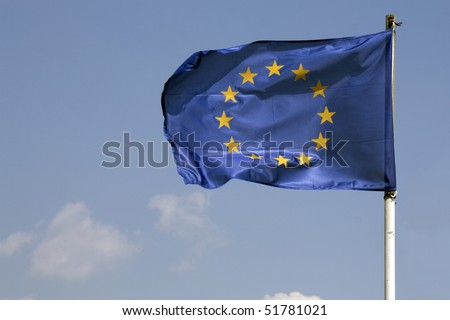 Waving blue flag of Europe Union against blue sky