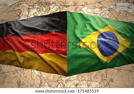 Waving Brazilian and German flags on the of the political map of the world - stock photo