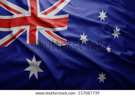 Waving colorful Australian flag - stock photo