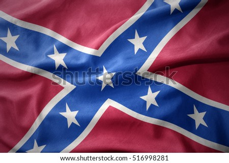 waving colorful confederate flag . Navy jack.