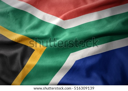 waving colorful national flag of south africa.