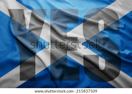 Waving colorful Scottish flag with YES word