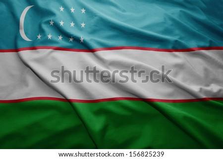 Waving colorful Uzbekistan flag - stock photo