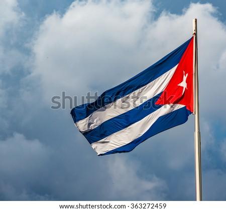 waving cuban flag flying over Revolution Square in Havana Cuba - stock photo