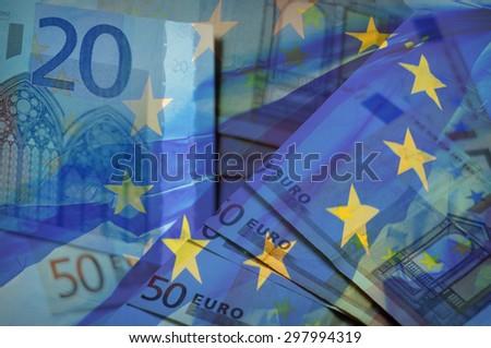 Waving EU flag on a euro money - background - stock photo