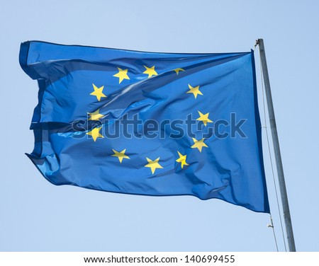 Waving european flag on a blue sky