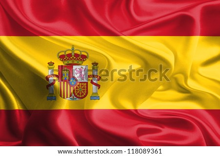 Waving Fabric Flag of Spain - stock photo