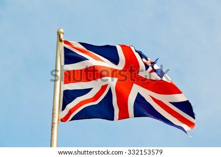 waving flag in the blue sky british colour and wave - stock photo