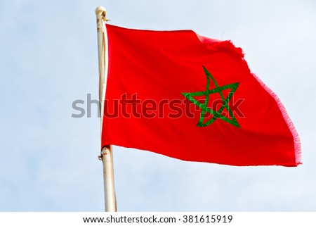 waving flag in the blue sky tunisia  colour and wave - stock photo