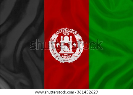 """waving flag of Afghanistan - an inscription in Arabic, """"I bear witness that there is no God but Allah, and still bear witness that Muhammad - the Messenger of Allah"""" - stock photo"""